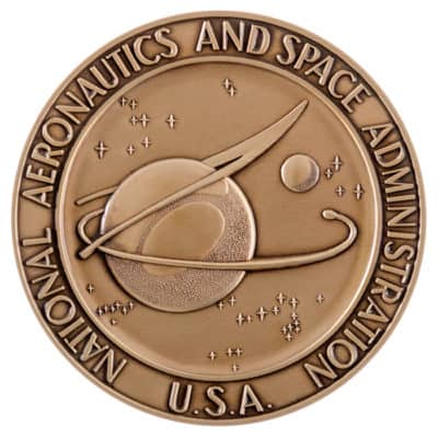 National Aeronautics and Space Administration First Flight Medallion Back
